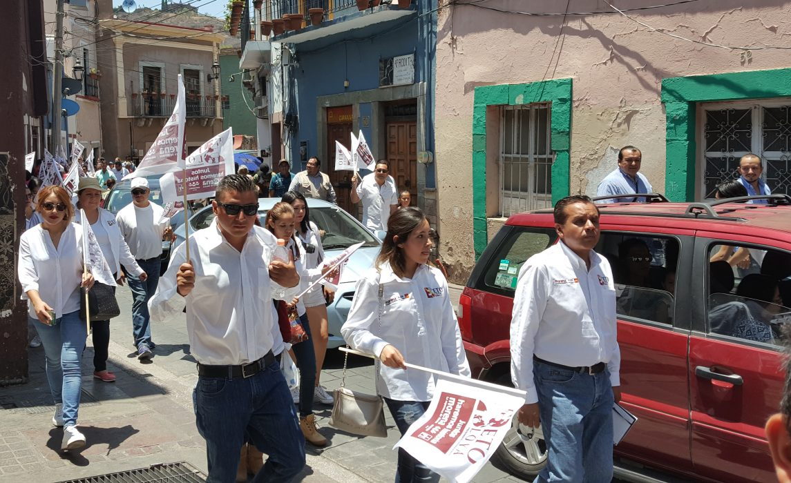 Supporters of MORENA march in the city of Guanajuato, a central Mexico state capital whose mines once rated as one of the world's most important sources of silver.